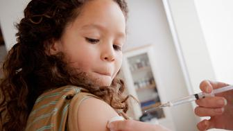 USA, California, Los Angeles, Girl (8-9) having vaccination