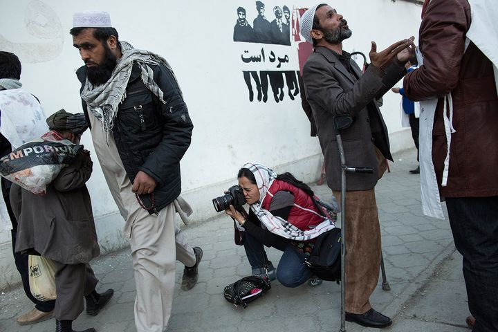 Mariam Alimi, a participant in Sahar Speaks, photographs in Kabul. Sahar Speaks was borne out of Ferris-Rotman's anger a