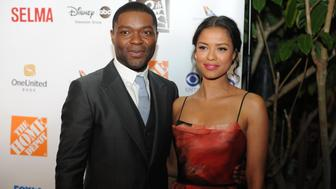 HOLLYWOOD, CA - FEBRUARY 04:  Actor David Oyelowo with Gugu Mbatha-Raw arrive at the 6th Annual AAFCA Awards Taglyan Cultural Complex on February 4, 2015 in Hollywood, California.  (Photo by Unique Nicole/Getty Images)