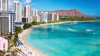 Resort travel vacation destination, Waikiki Beach with Diamond Head Crater. hotels and resorts around beach in Honolulu, Oahu, Hawaii, USA.