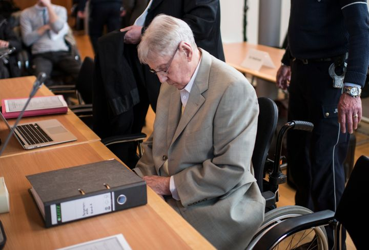 Reinhold Hanning, a former guard at Auschwitz sits in a courtroom before his trial in Detmold, Germany. The trial of for