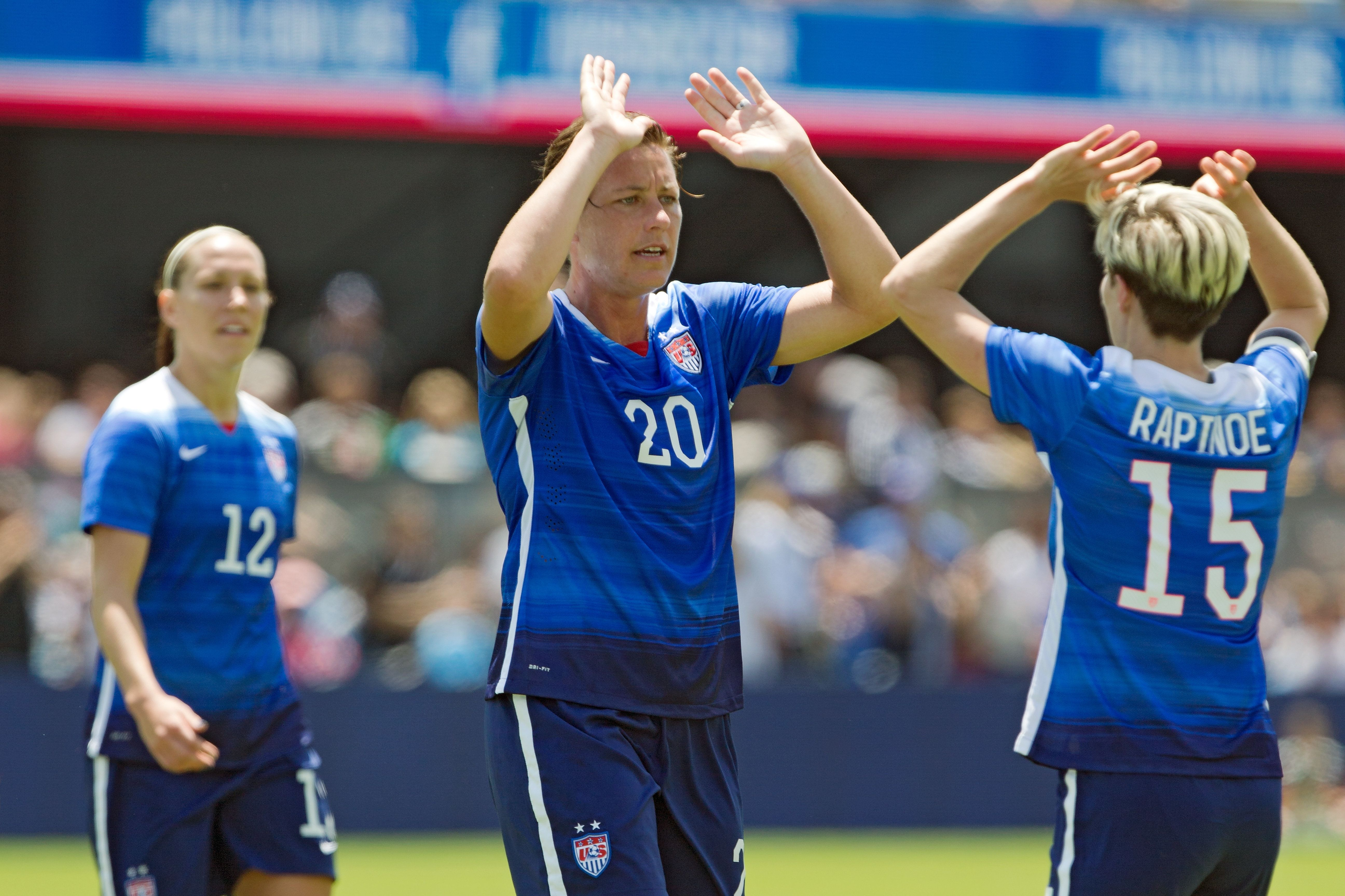 SAN JOSE, CA - MAY 10:  Megan Rapinoe #15 congratulates Abby Wambach #20 of the United States after scoring her second goal against Ireland in the first half of their international friendly match on May 10, 2015 at Avaya Stadium in San Jose, California.  The U.S. won 3-0.  (Photo by Brian Bahr/Getty Images)