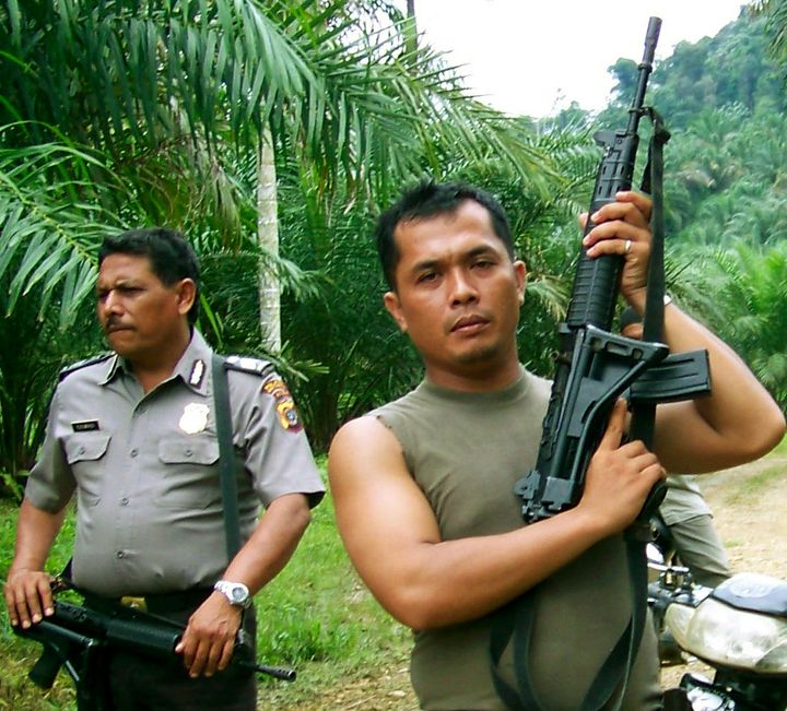 Police from the Aceh Tamiang district prepare to enter an illegal palm oil plantation inside the Leuser Ecosystem in 2009.