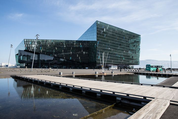 A couple of Rhode Island locals were the ones who noticed the background building's resemblance to the Harpa Concert Hall, pi