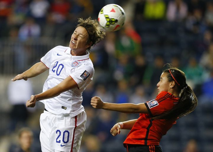 Wambach throws herself into one of her trademark thumping headers.