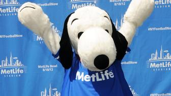 NEW YORK, NY - AUGUST 16: Mascot Snoopy poses at Random Acts of Football 2012 Snoopy Statue Dedication Ceremony at the MetLife Building on August 16, 2012 in New York City.  (Photo by Desiree Navarro/Getty Images)