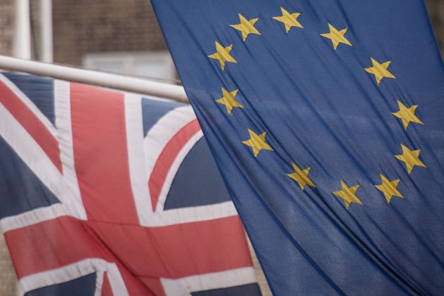 EU and UK flags fly above the EU Commission offices in Westminster,