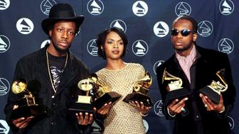 """The Fugees (from left) Wyclef Jean, Lauryn Hill and Prakazrel Michel pose with the Grammy they won for the Best R & B Performance by a Duo or Group for """"Killing Me Softly With His Song"""" at the 39th Grammy Awards at Madison Square Garden in New York February 30."""