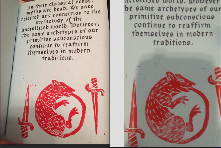 The ink spots near the sword are in totally different places in each version.