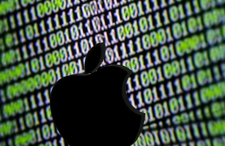 A 3D printed Apple logo is seen in front of a displayed cyber code in this illustration taken March 22, 2016. (REUTERS/Dado R
