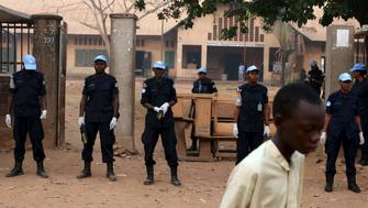 United Nations security personnel secure the entrance of a school used as an electoral centre at the start of the second round of presidential and legislative elections in the mostly Muslim PK5 neighbourhood of Bangui, Central African Republic, February 14, 2016. REUTERS/Siegfried Modola
