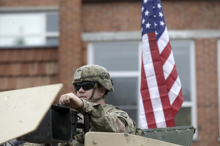 A U.S. soldier sits in his Humvee during the NATO Force Integration Unit inauguration event in Vilnius, Lithuaniaon&nbs