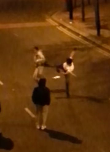 One of the teenagers attempts to kick the other in the head during the fight in