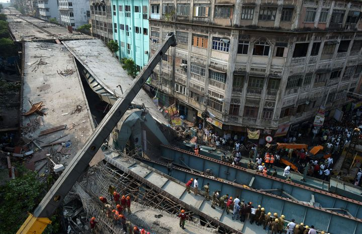 An overpass under construction collapsed in Kolkata, a major city in eastern India, killing at least 14 people with 100 peopl