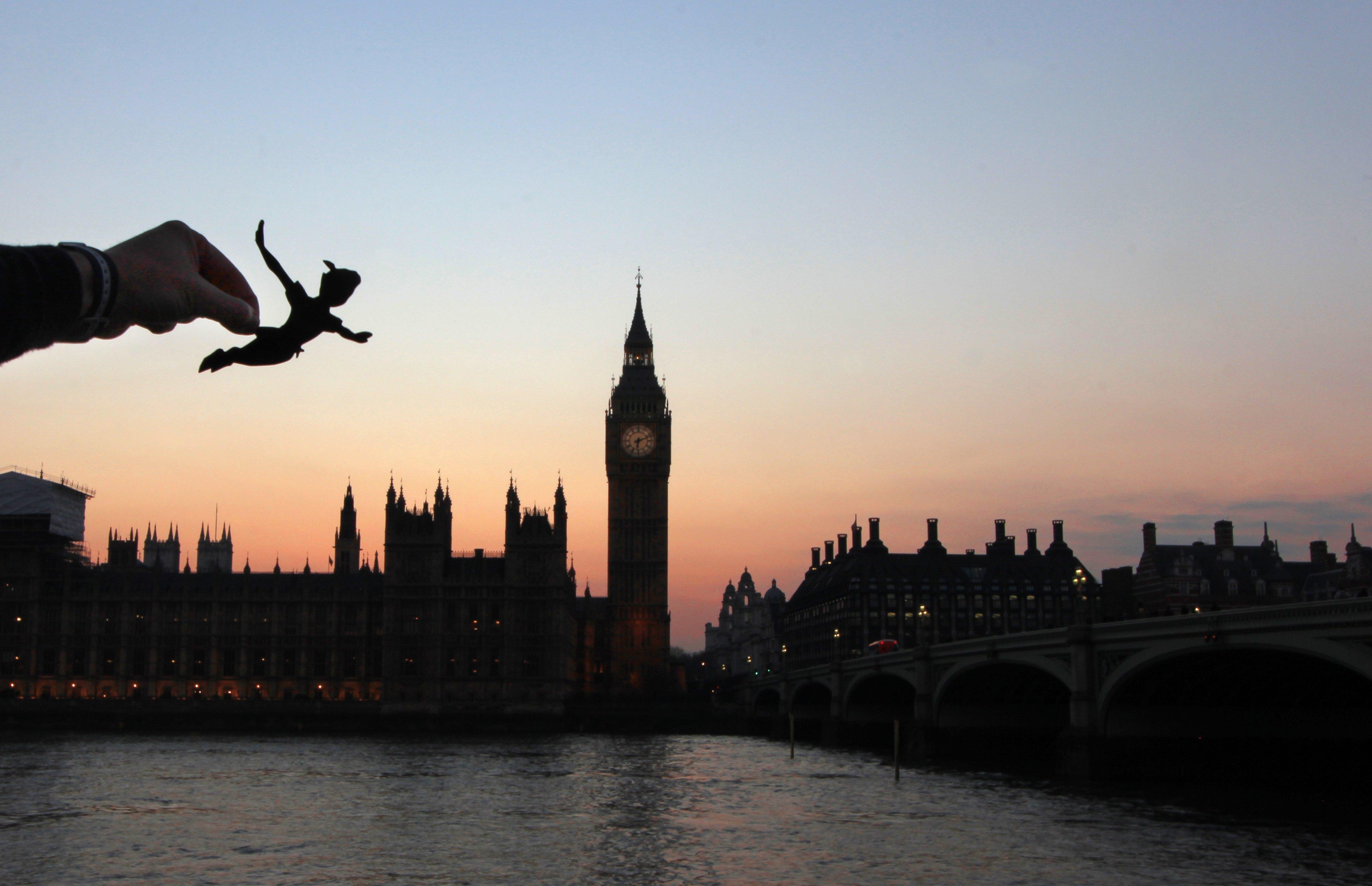 Peter Pan flies over Big Ben in London.