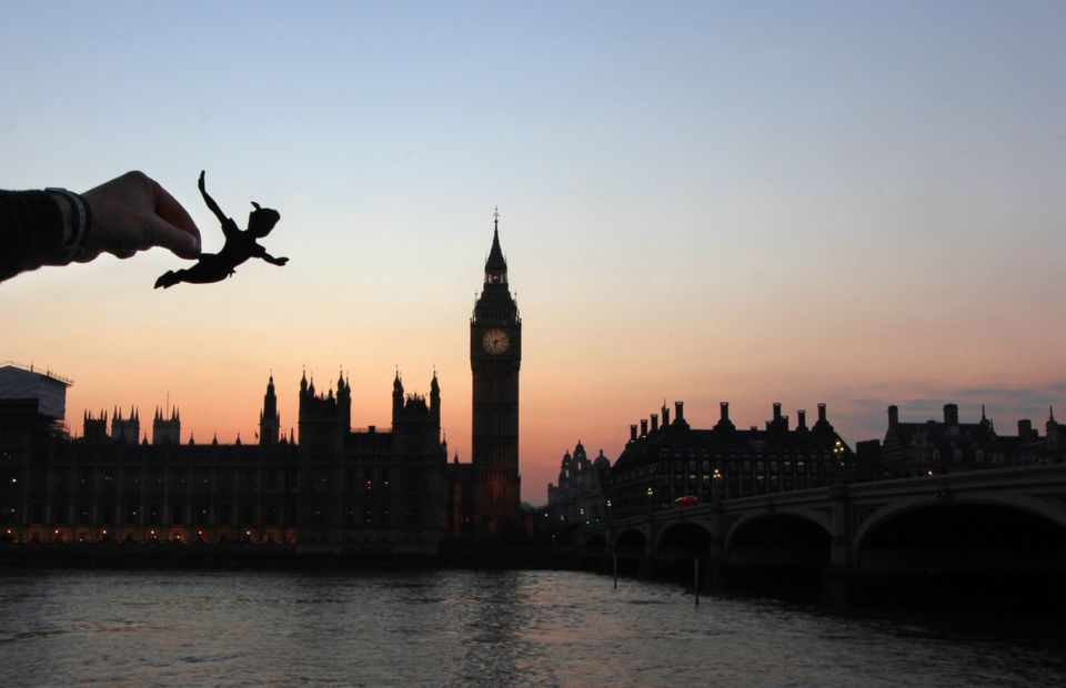 Peter Pan flies over Big Ben in London.
