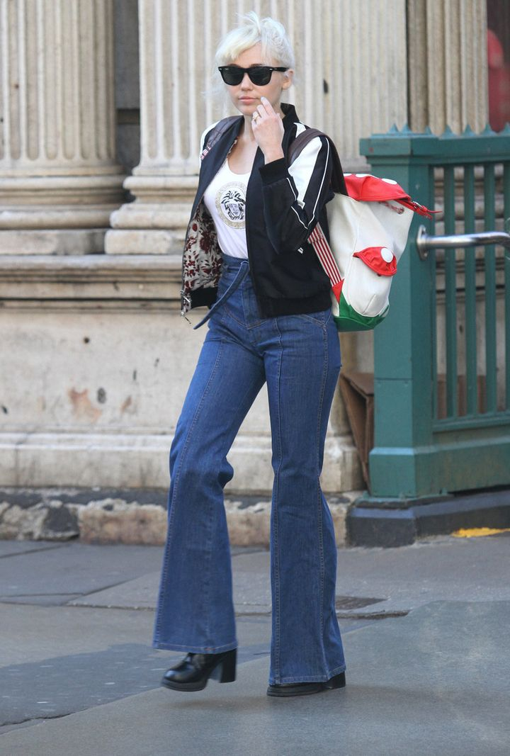 Miley Cyrus shows off her engagement ring while out on a walk around the Soho Neighborhood in downtown Manhattan on March 29,