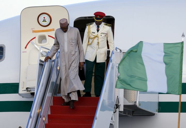 Nigeria's President Muhammadu Buhari (L) arrives on his official plane on March 30 to attend the Nuclear Security Summit in W