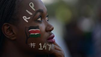 A woman attends a Musical concert in honour of the victims of the attack on Garissa University College in downtown Nairobi on April 14,  2015. The massacre, claimed by Somalia's Al-Qaeda-linked Shebab insurgents on a university campus in Kenya's nothern town of Garissa, claimed the lives of 142 students, three police officers and three soldiers at the university in the northeastern town of Garissa.  AFP PHOTO / SIMON MAINA / AFP / SIMON MAINA        (Photo credit should read SIMON MAINA/AFP/Getty Images)
