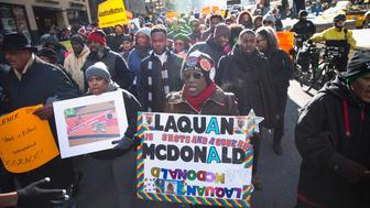 CHICAGO, IL - DECEMBER 31:  Demonstrators calling for an end to gun violence and the resignation of Chicago Mayor Rahm Emanuel march through downtown on December 31, 2015 in Chicago, Illinois. The shooting deaths by police of a 19-year-old college student Quintonio LeGrier and his 55-year-old neighbor Bettie Jones and a recently released video showing the shooting of 17-year-old Laquan McDonald by Chicago Police officer Jason Van Dyke have sparked dozens of protests in the city. Yesterday Emanuel announced several changes that would take place in the police department with the hope of preventing future incidents.  (Photo by Scott Olson/Getty Images)