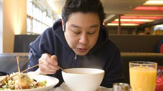 Man eating in restaurant