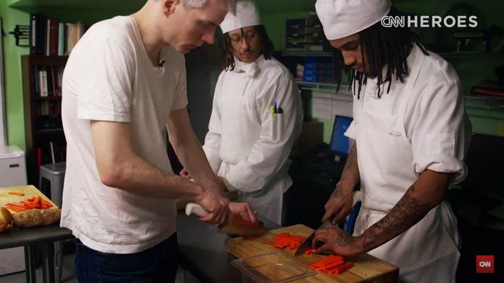 Chrostowski teaches a student some knife skills.
