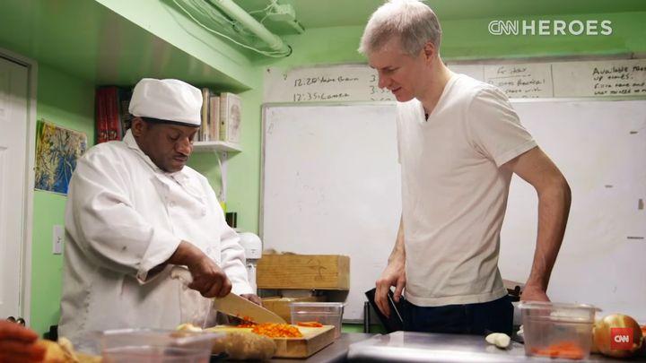 Chrostowski helps a student.
