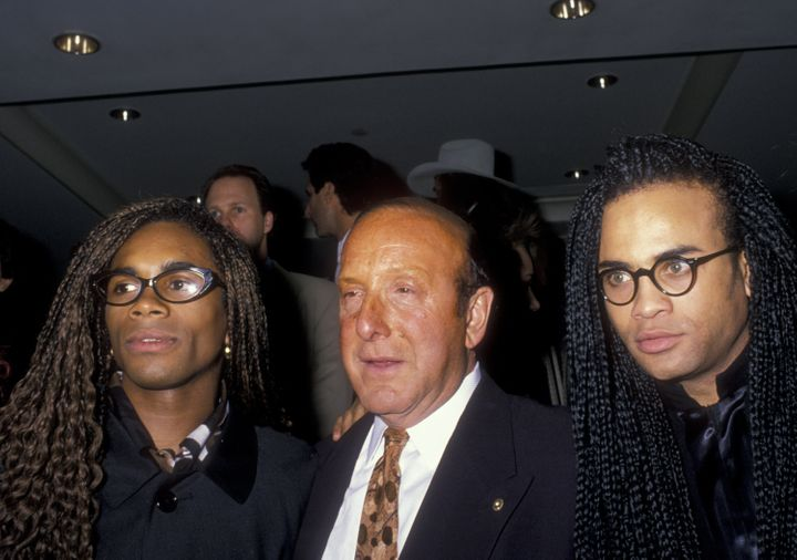 Rob Pilatus and Fab Morvan of Milli Vanilli and Clive Davis attend Arista Records Pre-Grammy Awards Party on February 20, 199