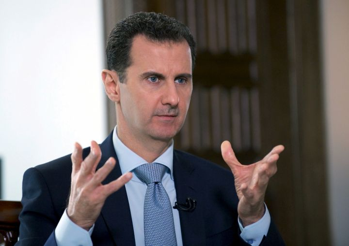 Syria's President Bashar al-Assad speaks during an interview with Russia's RIA news agency, in Damascus, Syria in this handou
