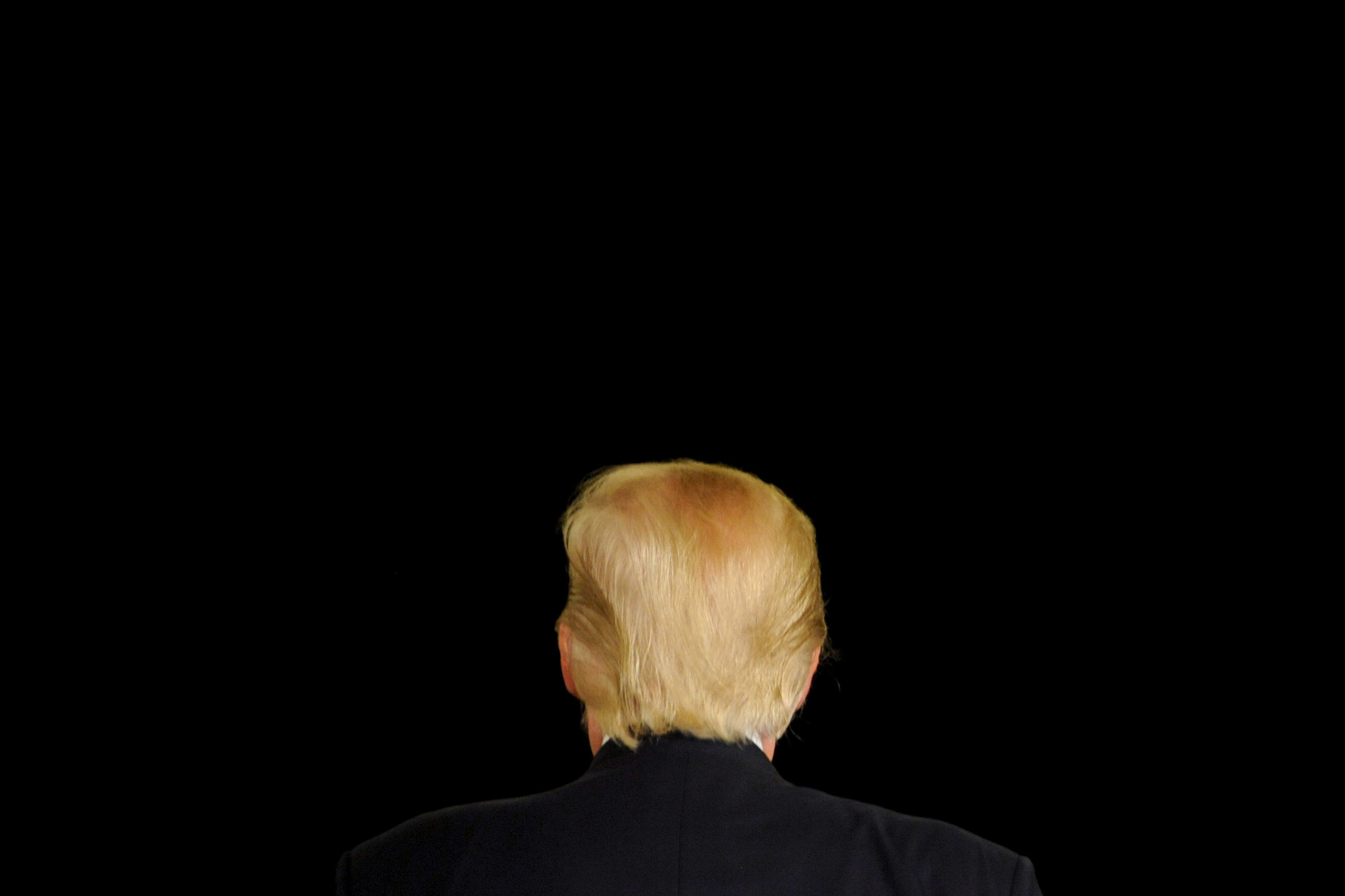 Republican U.S. presidential candidate Donald Trump turns away from the cameras as he speaks at a town hall event in Appleton, Wisconsin, March 30, 2016. REUTERS/Mark Kauzlarich