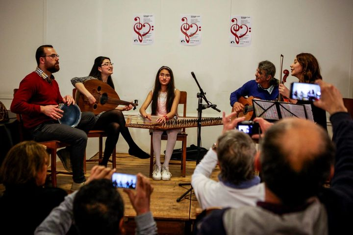 "Basel (right), Shaza (center) and Jawa (left) play instruments and sing at the ""Syrians Got Talent"" concert on Thursday eveni"