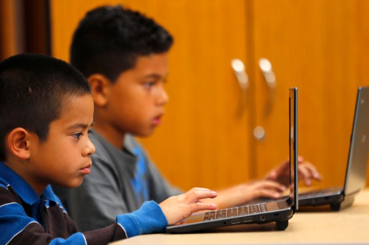Students work on laptop computers at Monarch School in San Diego, California