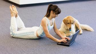 Woman Stretching While Using Laptop Computer