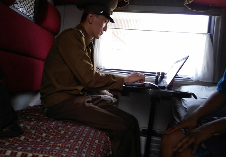 North Korean authorities, from train conductors to local police officers, can examine digital devices such as cameras, cell phones and laptops, Chu said. A customs officer inspects a passenger's laptop at Tumangang railway station.