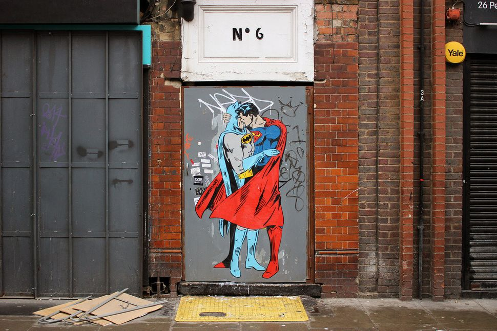 Two beloved superheroes share a kiss in this mural painted in Soho, London.