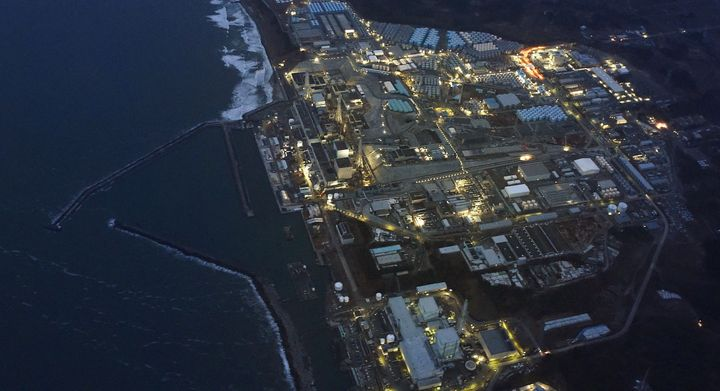 Tokyo Electric Power Co.'s tsunami-crippled Fukushima Daiichi nuclear power plant is illuminated for decommissioning operation in this aerial view photo taken March 10, 2016, a day before the five-year anniversary of the 2011 earthquake and tsunami disaster.