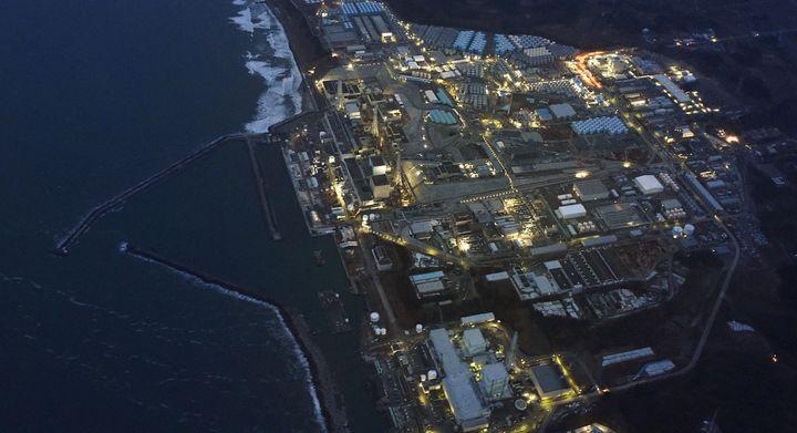 Tokyo Electric Power Co.'s tsunami-crippled Fukushima Daiichi nuclear power plant is illuminated for decommissioning operatio