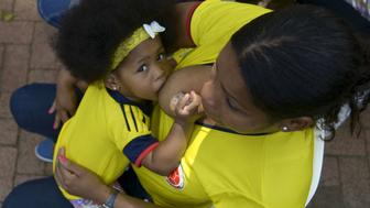 A Colombian woman breastfeeds her baby at San Vicente Foundation hospital on August 01, 2014 in Medellin, Antioquia department, Colombia. More than 100 mothers with their children, participated in the event called 'Big Lactation', (Gran Lactancia in Spanish) to encourage breastfeeding as a means to improve infants' health. AFP PHOTO/Raul ARBOLEDA        (Photo credit should read RAUL ARBOLEDA/AFP/Getty Images)