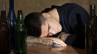 Drunk man sleeping on the table after party