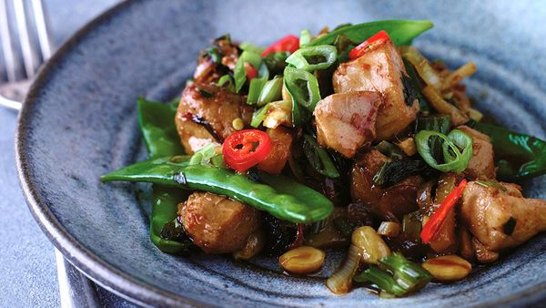 Chicken legs and thighs are terrific in stir-fries, since the dark meat tends to soak up the delicious sauce (here, it's chil