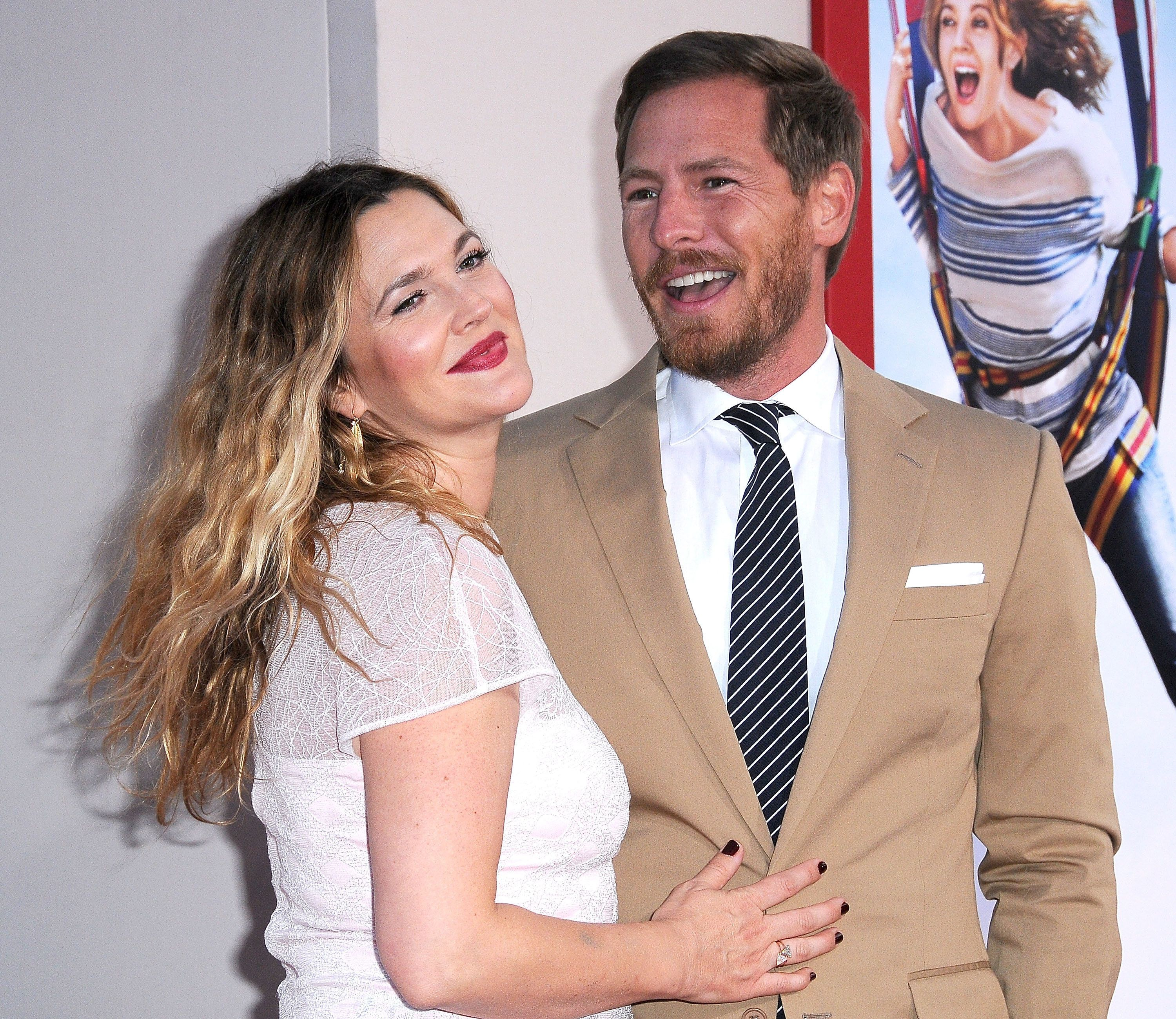 HOLLYWOOD, CA - MAY 21:  Actress Drew Barrymore (L) and husband actor Will Kopelman arrive at the Los Angeles Premiere 'Blended' on May 21, 2014 at TCL Chinese Theatre in Hollywood, California.  (Photo by Barry King/FilmMagic)