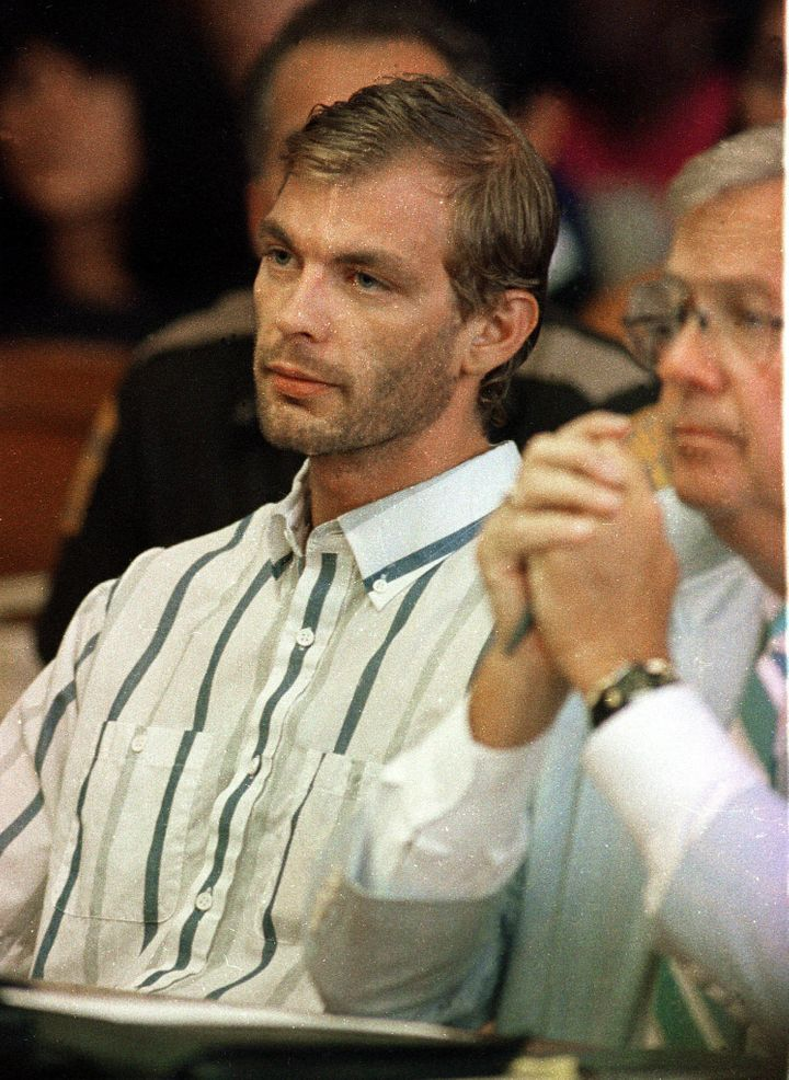 Jeffrey Dahmer, left, pictured during his initial court appearancein Milwaukee County Circuit Court in July 1991. He wa