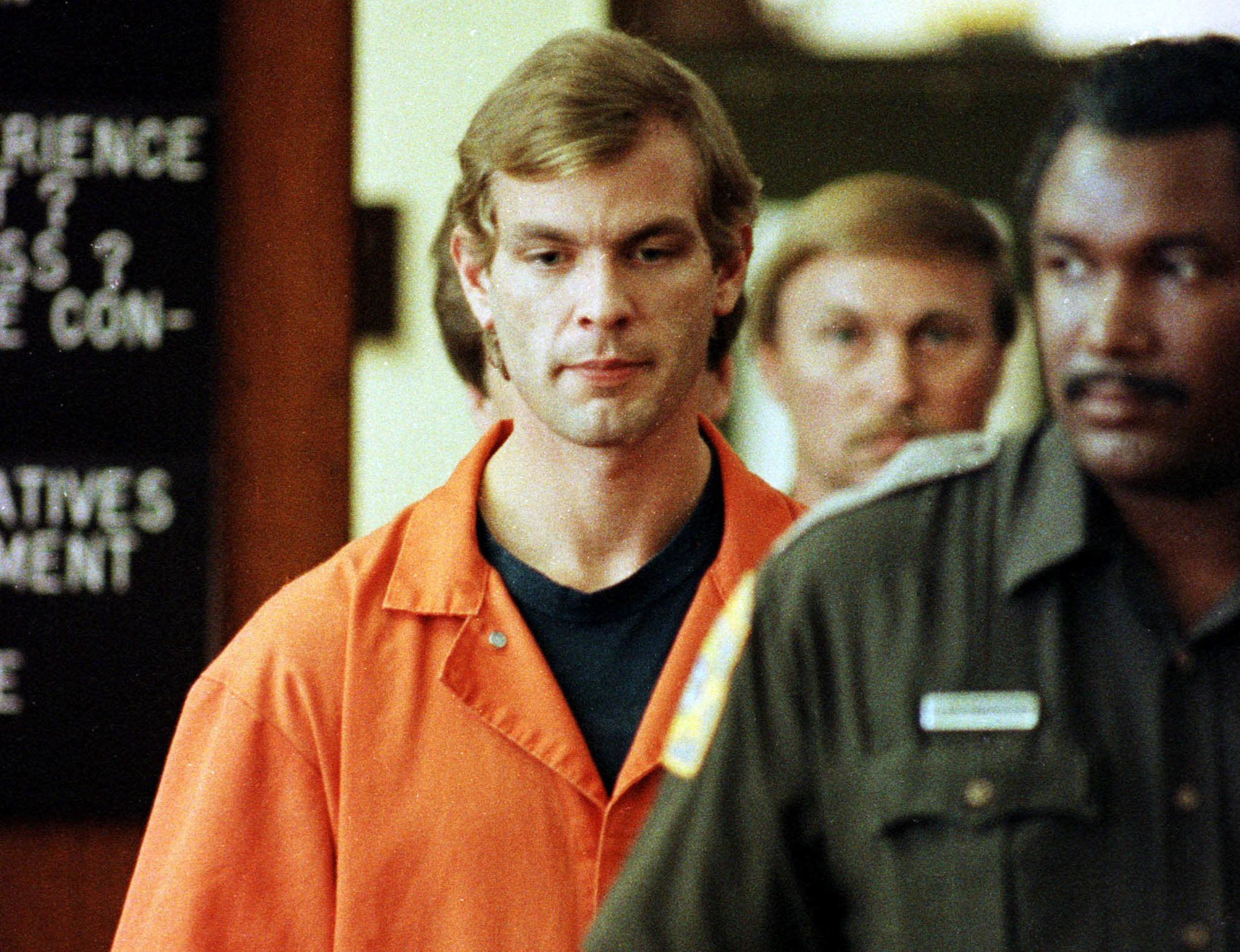 Serial killer Jeffrey Dahmer is escorted into a Milwaukee County Circuit Court by a Milwaukee County Sheriffs Deputy for his second appearance in this July, 1991, file photo. Dahmer was found guility of the murders of 16 young men, and sentenced to life in prison in February of 1992.  AF/JP