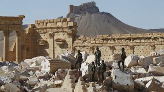 "Syrian army soldiers stands on the ruins of the Temple of Bel in the historic city of Palmyra, in Homs Governorate, Syria April 1, 2016. The Fakhreddin's Castle is seen in the background. REUTERS/Omar Sanadiki      TPX IMAGES OF THE DAY     SEARCH ""PALMYRA SANADIKI"" FOR THIS STORY. SEARCH ""THE WIDER IMAGE"" FOR ALL STORIES"