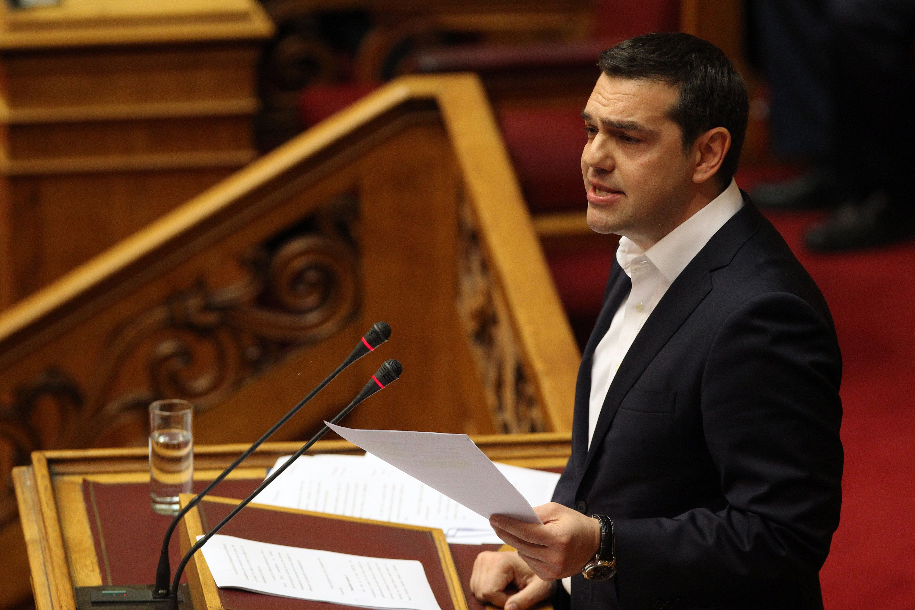 ATHENS, March 29, 2016-- Greek Prime Minister Alexis Tsipras addresses Parliament to open debate over justice issues in Athens, Greece on March 29, 2016. (Xinhua/Marios Lolos via Getty Images)