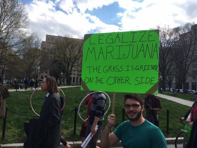 A protester marches on K Street in Washington, D.C. on April 2, 2016, after smoking marijuana in front of the White House.