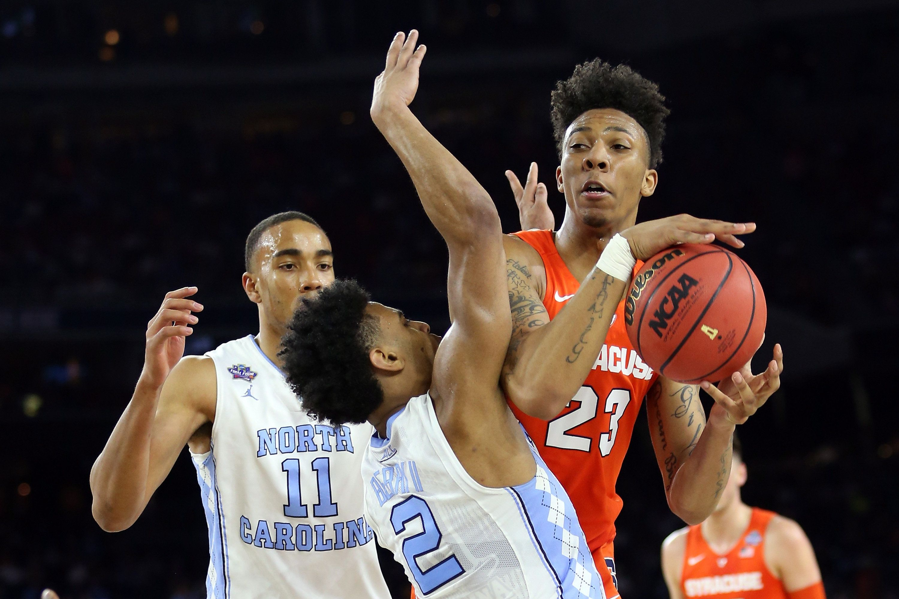 HOUSTON, TEXAS - APRIL 02:  Malachi Richardson #23 of the Syracuse Orange handles the ball against Joel Berry II #2 of the North Carolina Tar Heels in the second half during the NCAA Men's Final Four Semifinal at NRG Stadium on April 2, 2016 in Houston, Texas.  (Photo by Streeter Lecka/Getty Images)