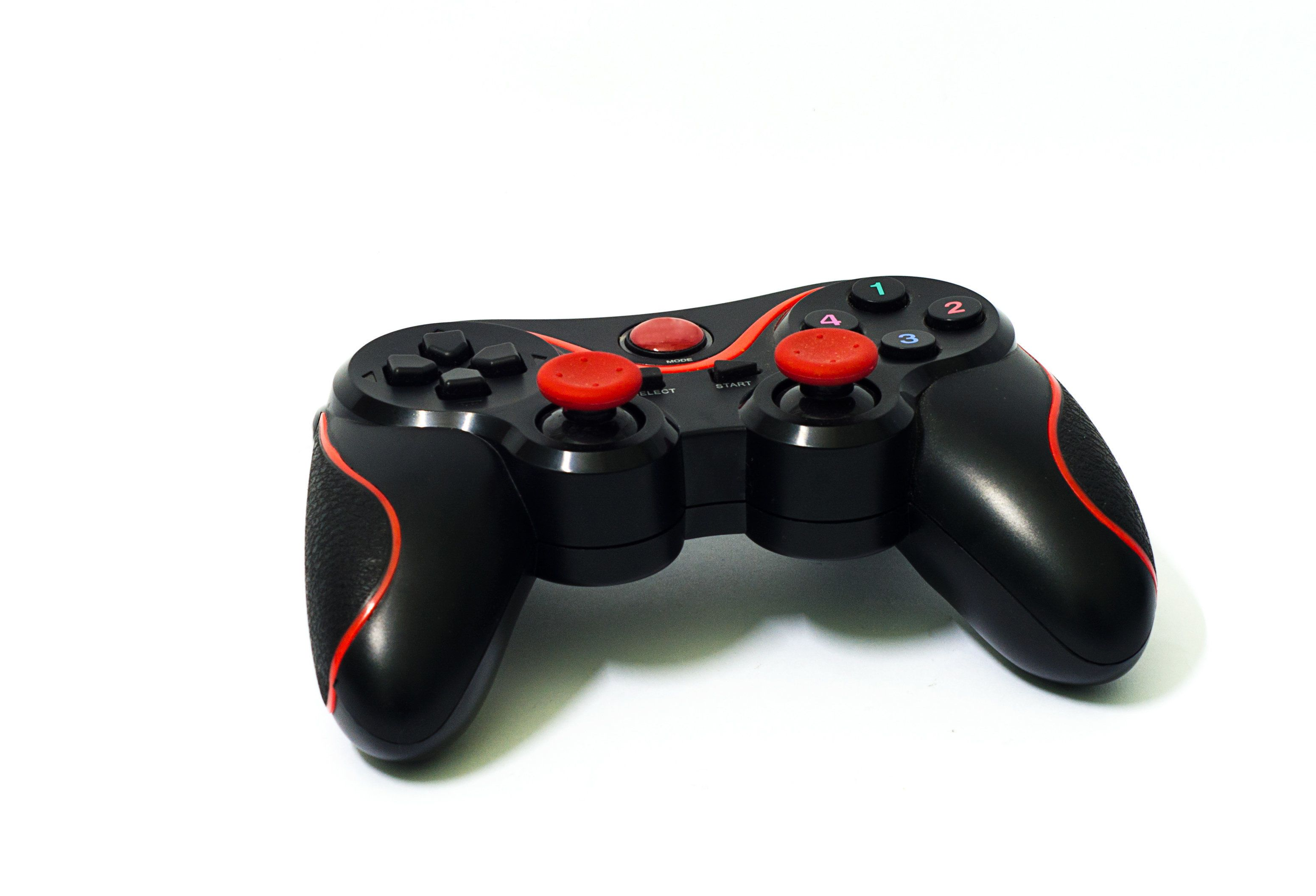 Generic black and red gamepad isolated on white.