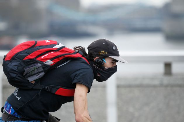 A cycling on London Bridge in April 2014, when industrial pollution and Sahara dust blanketed the country...