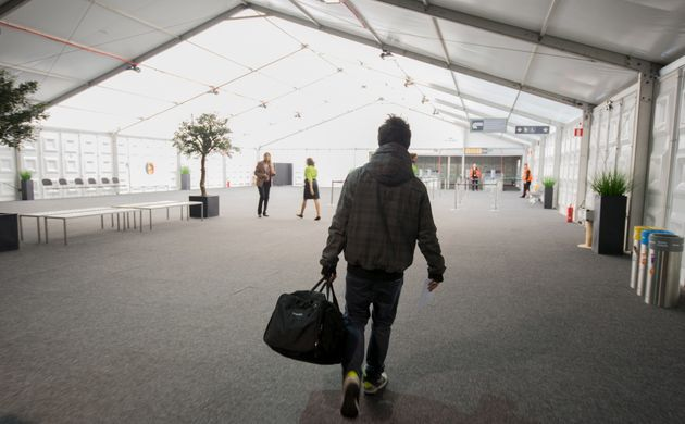 A passenger arrives at Brussels Airport, which partially re-opened following a bomb blast 12 days ago,...